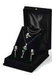 Emerald platinum set. White gold set with emeralds and diamonds, on white Royalty Free Stock Image