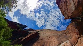 Emerald Pools Trail at Zion National Park. This is a view looking up at the rock walls that stand over the Upper Emerald Pool at Zion National Park Royalty Free Stock Image