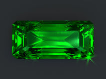 Emerald rectangular cut isolated. Precious emerald gem. Rectangle cutting with sparkling dazzling glare. Isolated unset green gemstone Stock Images