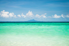 Emerald sea and blue sky in Thailand Royalty Free Stock Image