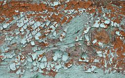 Emerald shade coloured cracked paint peeling on wood texture stock photography