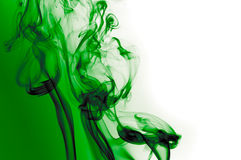 Emerald smoke. Green smoke waves over white and green background Royalty Free Stock Photography