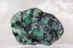Emerald in stone Stock Photo