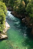 Emerald green river water in Patagonia, Chile with whitewater royalty free stock images