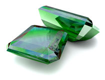 Emeralds. Two green emeralds reflecting themselves Royalty Free Stock Image