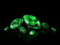 Emeralds on black surface Royalty Free Stock Photography