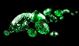 Emeralds on black surface Stock Image