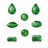 Emeralds Set Isolated Objects. Emeralds set different cut - round, drop, pear, oval, octagon and race. Green shiny three-dimensional jewelry on a white Stock Photo