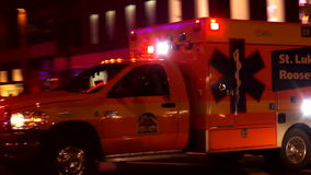 Emercency ambulance driving through New York USA cityscapes stock footage