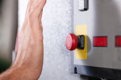 Emergency � Man shutting machine of Royalty Free Stock Image