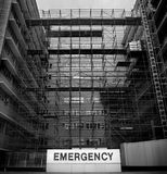 Emergency. Sign at a hospital with chaotic construction work going on stock photo