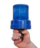 Emergency. Hand is holding a blue emergency signal light - isolated Stock Photography