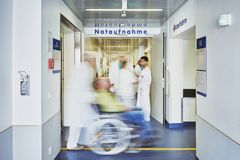 Emergency admission hospital doctor wheelchair team personnel stock images