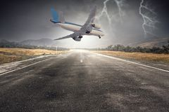 Emergency airplane landing. Mixed media. Airplane in sky that going down for landing. Mixed media Stock Photography