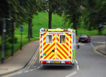 Emergency ambulance. View of ambulance reacting to 999 call. Zoom blur added for effect Stock Images