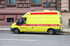 Emergency ambulance car with blue flashing light on the roof par. ST. PETERSBURG, RUSSIA - JULY 31, 2016: Emergency ambulance car with blue flashing light on the Royalty Free Stock Photography