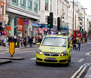 Emergency Ambulance in Oxford Street. Emergency Ambulance speeds along Oxford Street, London, in response to 999 call Royalty Free Stock Image