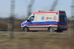 Emergency ambulance  rushing on signal for help Stock Photography