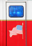 Emergency blue light with United States Flag Stock Photography