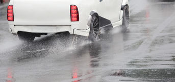 Emergency braking car on wet road Stock Photography