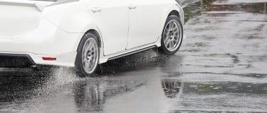Emergency braking car on wet road Stock Image