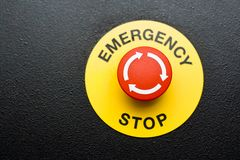 Emergency button. Red emergency button on black panel Stock Image