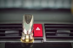 Emergency button in car and air conditioned perfume Royalty Free Stock Photography