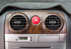 Emergency button in car with air vents royalty free stock photo