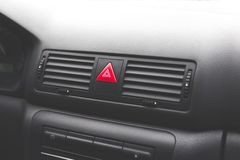 Emergency button on the car dashboard royalty free stock photos