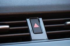 Emergency Button in Luxury Car. Black emergency button with red triangular symbol in luxury car royalty free stock photos