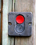 Emergency button on wooden background. Red emergency button on wooden background Royalty Free Stock Image