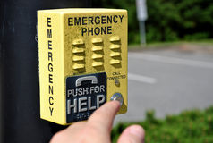 Emergency Call Box. Woman prepare to press emergency phone button royalty free stock image