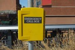 Emergency Call Box. A yellow emergency call box Stock Image
