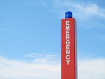 Emergency call box sign with blue strobe. An emergency call box sign with a blue strobe on the top. Located in parking lots, these are to provide the public royalty free stock photos