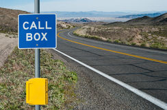 Emergency Call Box and Sign. A sign informs motorists of telephone assistance available on a desert highway in California Stock Photo
