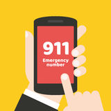 Emergency call 911 concept. Hand holding mobile phone. It can be used for a website, mobile application, presentation, corporate identity design, wherever you Stock Photos