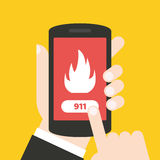 Emergency call 911 concept. Hand holding mobile phone. It can be used for a website, mobile application, presentation, corporate identity design, wherever you Royalty Free Stock Images