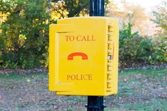 Emergency call police yellow box in a New-York city park. USA stock image