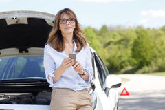 Emergency call on the road Stock Photography