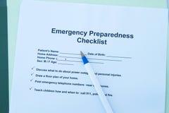 Emergency checklist. Emergency preparedness checklist with pen and folder Royalty Free Stock Image