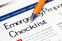 Emergency Checklist and ballpoint pen. Close-up stock photo