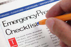 Emergency Checklist. And hand with ballpoint pen. Close-up Stock Photo