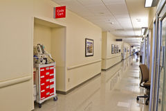 Emergency Code Cart Hospital Hallway. Emergency Code Cart with red drawers labeled with various medical supplies standing ready in recess of hospital corridor on Royalty Free Stock Images