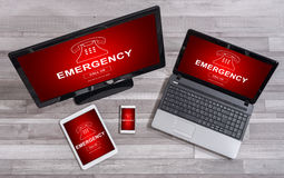 Emergency concept on different devices. Emergency concept shown on different information technology devices Stock Images