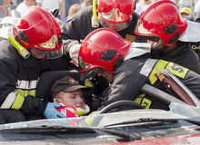 Emergency Crew Removing A Victim From A Car Accident Royalty Free Stock Image