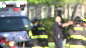 Emergency crews respond after an accident (5 of 8). Shot of emergency workers responding to a traffic accident stock footage