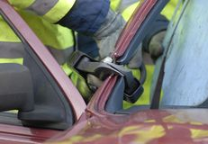 Emergency cut. Fire crew cutting a car roof off to release trapped casualties Royalty Free Stock Photography
