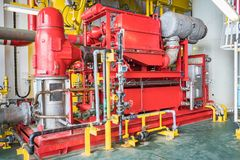 Diesel emergency fire water pumo. Emergency diesel engine fire water pump at oil and gas platform for safety,fire fighting equipment stock photos