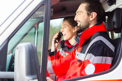Emergency doctor driving in ambulance Stock Images