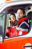Emergency doctor driving in ambulance Stock Photo
